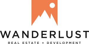 Wanderlust Real Estate & Development Logo